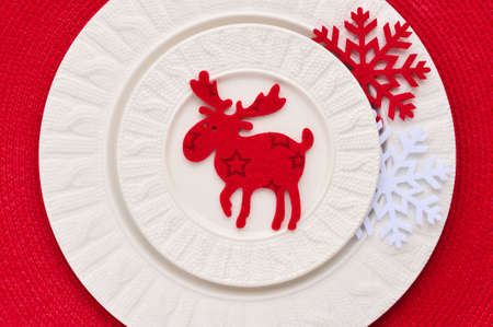 christmas elk: Christmas decoration elk and snowflakes on plate. Christmas holidays concept