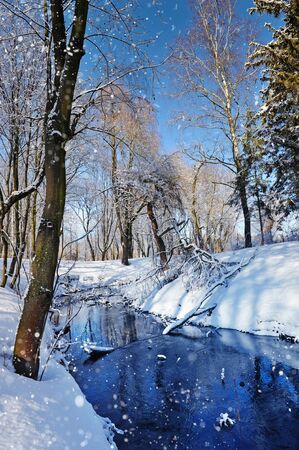 wintery day: Winter landscape with the river in frosty sunny day Stock Photo
