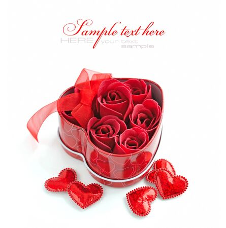 loveheart: Red Roses in Gift Box and decorative Hearts on White Background Stock Photo