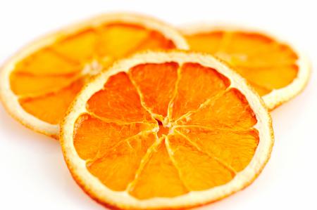 dried orange: Three dried orange slices from above on white background