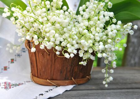 majalis: Basket with lilies of the valley (Convallaria majalis)
