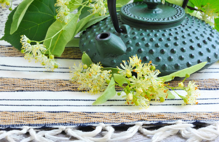 nontraditional: Teapot with linden tea and flowers Stock Photo