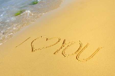 i love you sign: Inscription I love you on a sandy beach