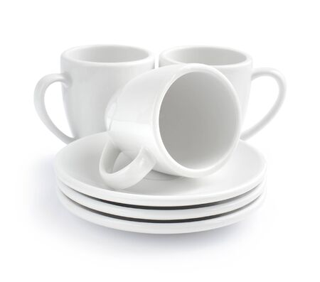 saucers: Empty white coffee cups and saucers on a white background