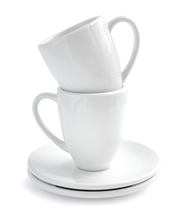 saucers: Empty white coffee cups and saucers on white background