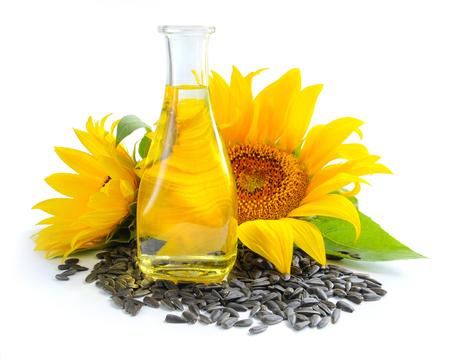 semillas de girasol: El aceite de girasol es con las flores de girasol y grano en el fondo blanco