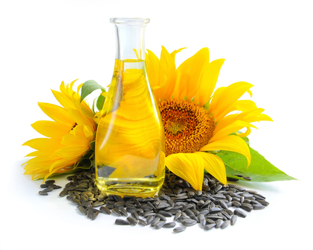 sunflower seeds: Sunflower oil is with the flowers of sunflower and grain on white background