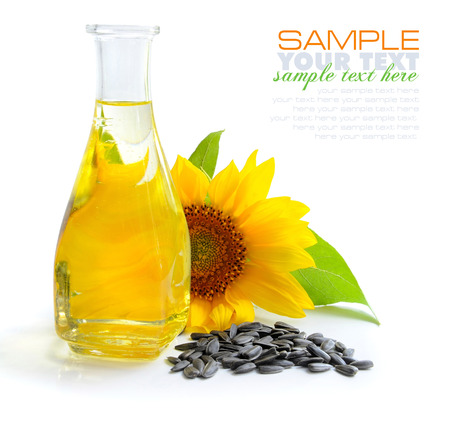 Sunflower oil with flower and by seed on white background Stock Photo