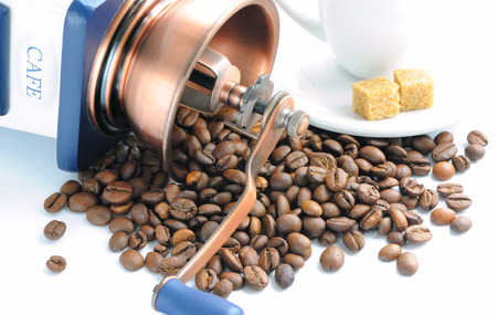 oldfashioned: Old-fashioned coffee grinder and roasted coffee beans Stock Photo