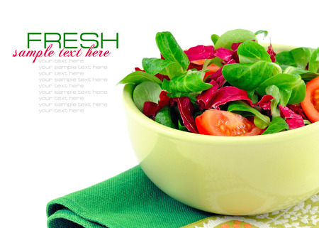 delicious: Fresh salad is in a dish on a white background