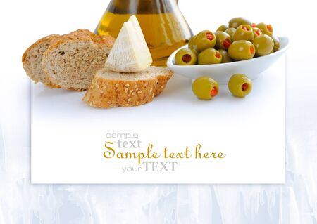 cheese bread: Green olives, oil, slices of bread and cheese are on a white background with space for text