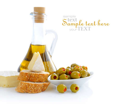 cheese bread: Green olives, oil, slices of bread and cheese are on a white background Stock Photo