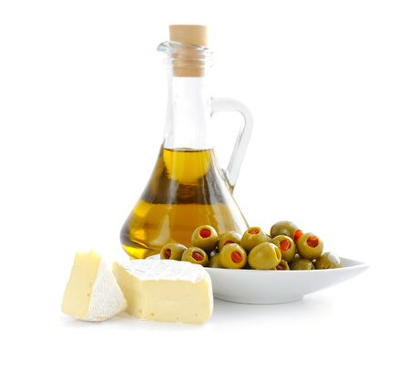 pimento: Green olives stuffed with pimento with the slices of cheese on a white background Stock Photo