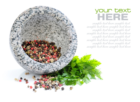 morter: Stone mortar with mixture of peppers and greenery of parsley on white background