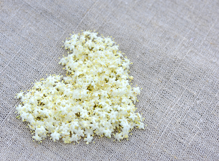 sackcloth: Heart from white flowers on sackcloth