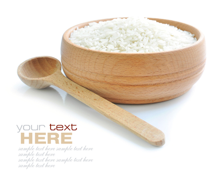Rice in wooden bowl and spoon isolated on white background