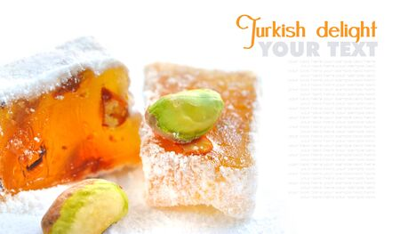 delight: Turkish delight (lokum) with pistachios on a white background, closeup