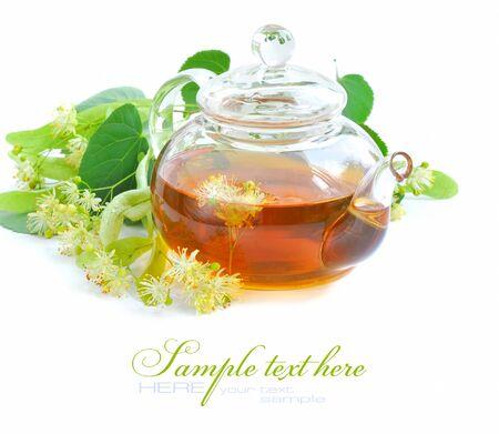 linden tea: Teapot with linden tea and flowers Stock Photo