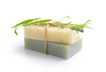 bar of soap: Handmade soap and lavender flowers on a white background