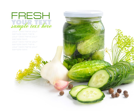 preserves: Preparing preserves of pickled cucumbers in jar with spices and herbs Stock Photo