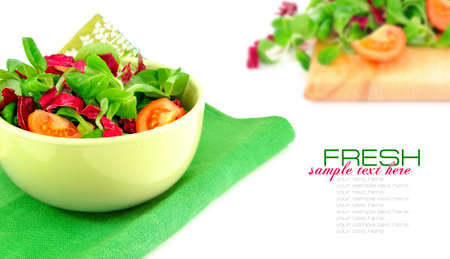 tomato slice: Fresh salad is in a dish on a white background