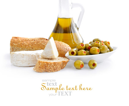 picking fruit: Green olives, oil, slices of bread and cheese are on a white background Stock Photo