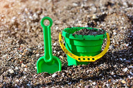 bucket and spade: A kids spade and bucket on a pebbled shore