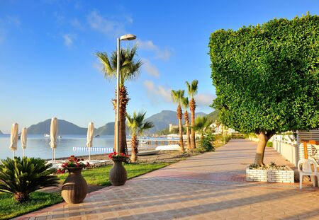 Seafront against the backdrop of the picturesque bay of blue sea and mountains. Marmaris. Turkey