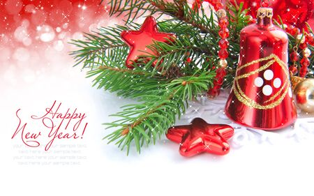 Branches of spruce are with christmas decorations on festive background Stock Photo