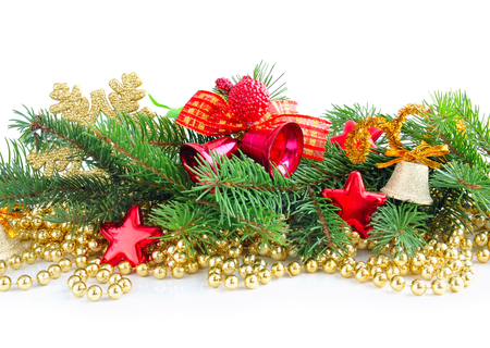 Branches of spruce are with christmas decorations on white background