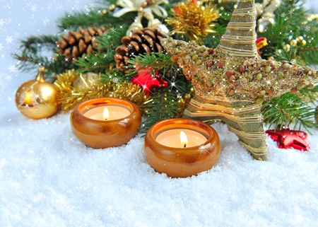 fire flower: Christmas background is with candles on snow Stock Photo