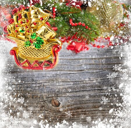 snowbound: Christmas decoration is a sledges on a snowbound wooden background