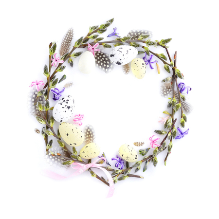 Easter wreath with easter eggs, pussy-willow branches and flowers. Circle border perfect for easter card or invitation