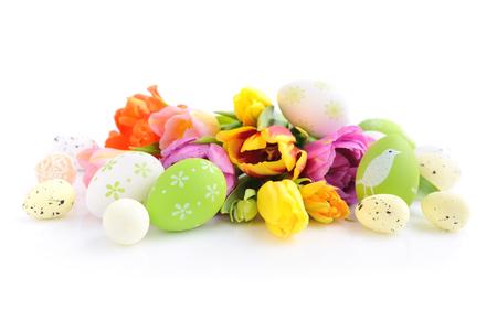 Easter eggs with tulips flowers on white background Reklamní fotografie
