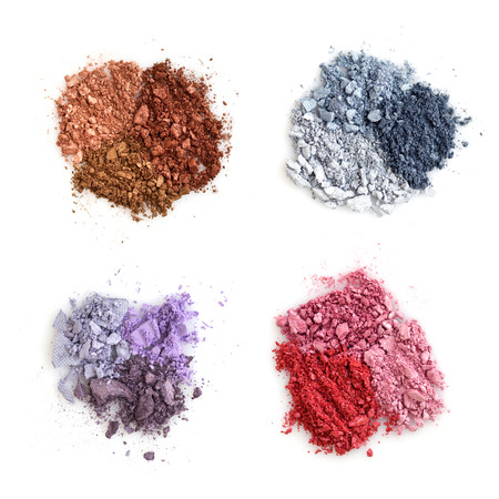 Crushed color eyeshadows on white background. Top view