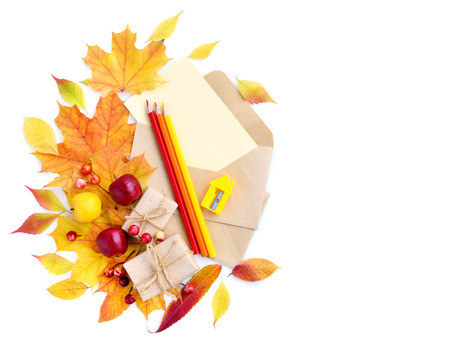 Autumn background with pencils, envelopes and colorful leaves. Top view. Space for your text. 스톡 콘텐츠