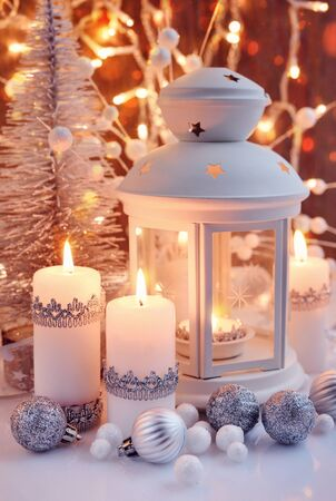 Christmas composition with lantern, candles and festive decorations. Christmas or New Year greeting card.