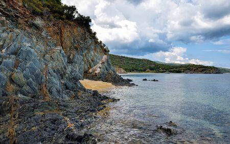 Coast with rocks, sea landscape and the beautiful clouds in the blue sky Zdjęcie Seryjne