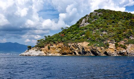 View of the shore from the sea. Landscape with the sea and beautiful clouds in the blue sky