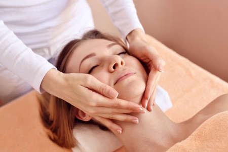 Beautiful woman receiving massage from female therapist in spa. Beauty wellness concept Zdjęcie Seryjne