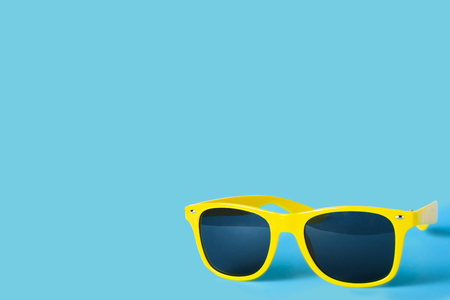 Yellow glasses isolated on a blue background, vacation, vacation, summer, sun