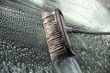 Brush for cleaning glass. Car wash with a brush, hand wash