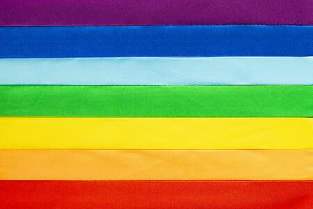 LGBT flag symbol made of satin ribbons.