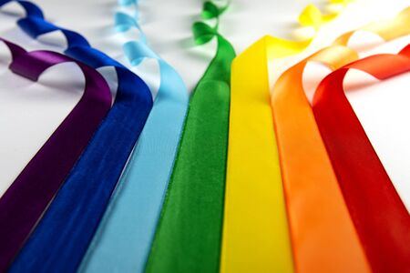 LGBT flag, rainbow symbol of minorities in the form of satin ribbons.