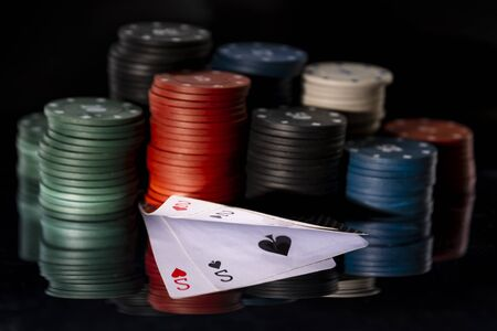 Poker ChipsPoker chips with cards on a mirror background 版權商用圖片