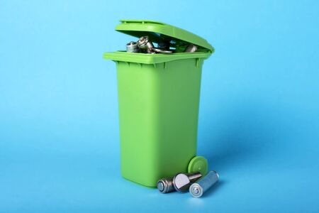 Dustbin on a blue background. Batteries, batteries. Waste recycling. Ecological concept Stok Fotoğraf
