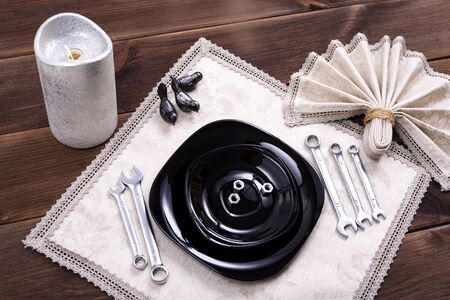 Table setting made of cutlery in the form of repair tools, wrenches Stock fotó