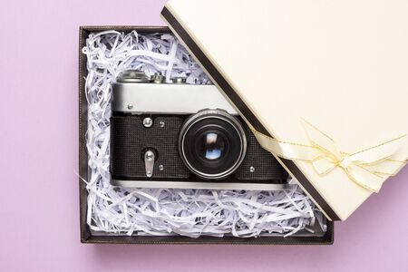 Vintage gift box on a pink background, top view