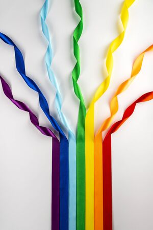 LGBT flag, rainbow symbol of minorities in the form of satin ribbons. Stop homophobia