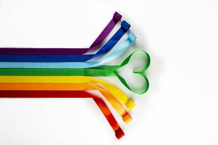 LGBT flag, rainbow symbol of sexual minorities in the form of satin ribbons. Stop homophobia